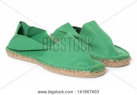 green espadrille in front of white background
