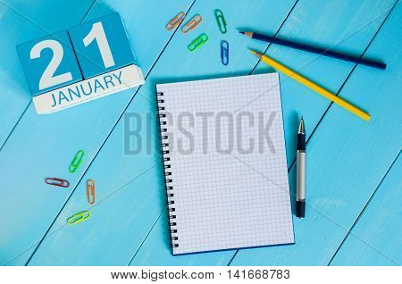 January 21st. Day 21 of month, calendar on teacher table background. Winter time. Empty space for text.