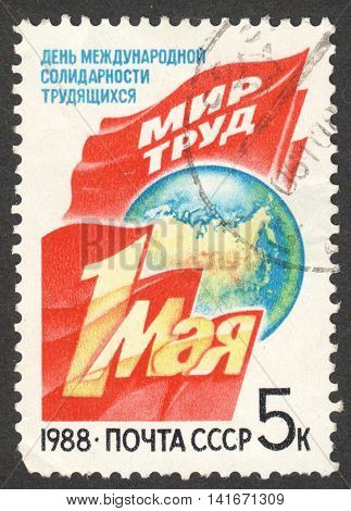 MOSCOW RUSSIA - CIRCA APRIL 2016: a post stamp printed in the USSR dedicated to Labour Day circa 1988