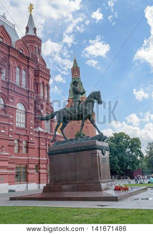 Moscow, Russia - July 07, 2016: Bronze statue of Marshal Zhukov near the building of the Historical Museum on Red Square