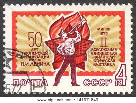 MOSCOW RUSSIA - CIRCA APRIL 2016: a post stamp printed in the USSR shows a pioneer trumpeter dedicated to All-Union Youth Stamp Exhibition circa 1972