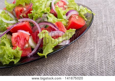 Side View On A Diagonal On A Plate With Fresh Salad Of Raw Vegetables Closeup