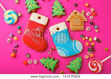 Different Christmas Gingerbread Cookies And Mixed Multicolored Candy
