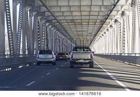 Richmond-San Rafael Bridge (also officially named the John F. McCarthy Memorial Bridge) with moving cars