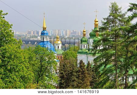 View of Vydubychi Monastery left bank of the Dnipro River and the modern part of city Kyiv, Ukraine