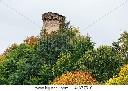 Old stone tower on the hill. Architectural Landmark in the tourist spot. Mestia City. Caucasus, Georgia, Zemo Svaneti