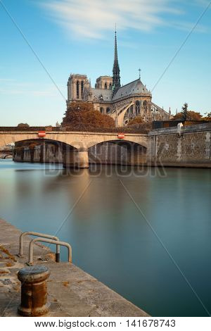 Paris River Seine with Notre-Dame cathedral and bridge in France.