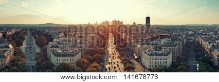 Paris sunset rooftop view of the city skyline with la Defense business district in France.