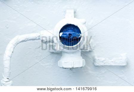 Blue control valve switch on a white surface