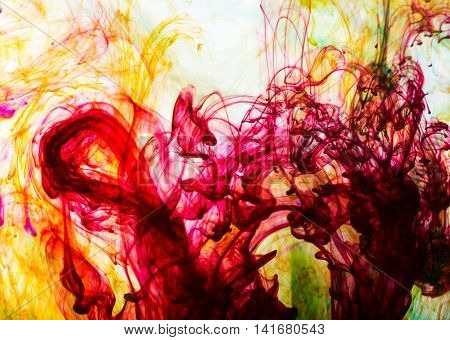 Acrylic colors and ink in water. Abstract background.
