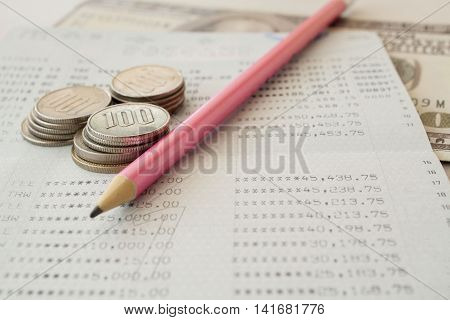 notebook of bank passbook report money deposit and withdrawal balance in account statement of financial