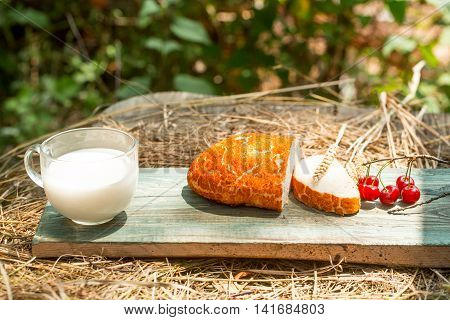 Bread Cherry And Cup Of Milk