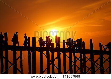 Silhouette sunset U Bein Bridge Mandalay Burma