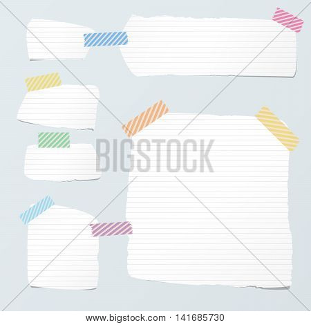 Pieces of cut white ruled note paper are stuck with striped sticky tape on light blue background.