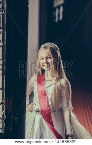 Small Girl With Miss Ribbon In Dress