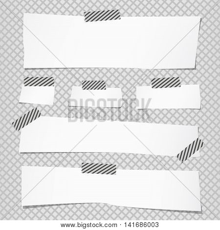Pieces of cut white note paper are stuck with striped sticky tape on grid pattern.