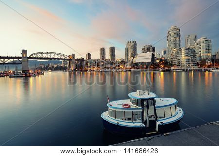 Vancouver False Creek at sunset with bridge and boat.