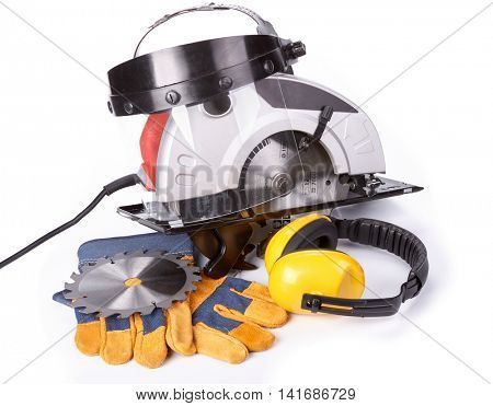 Handheld circular saw and protective clothes on a white background