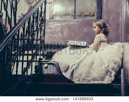 Small Girl Near Window With Basket And Book