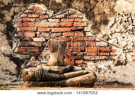 Old buddha statue in Wat Mahathat temple at Ayutthaya Thailand.