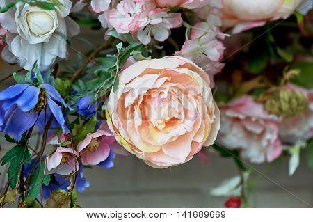 Beautiful intertwined flowers, peonies decorating the interior. White brick wall