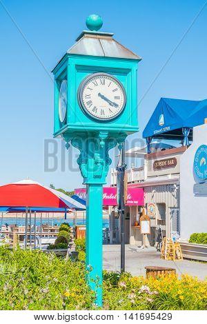 MONTAUK, LONG ISLAND, US, JUNE 18, 2016: Clock in center of Montauk village