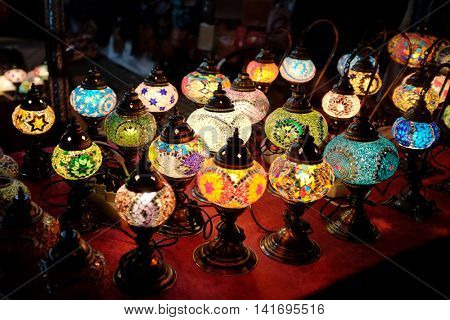 Colorful group of typical moroccan lamps for sale in a market