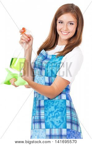 Smiling young woman holding bottle of chemistry for cleaning house. Beautiful happy girl with microfiber cloth and cleaning spray for window on white background. Housekeeper isolated portrait.