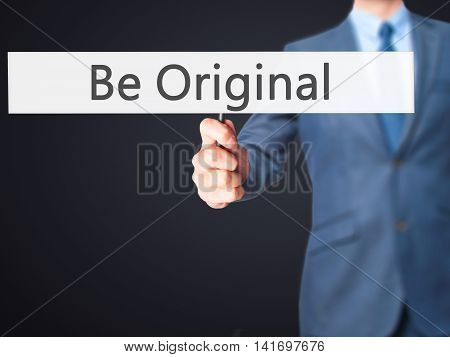 Be Original - Business Man Showing Sign