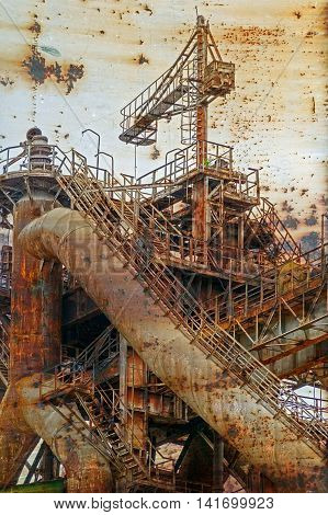 Rusty background with old steel furnace from Resita city Romania. Vintage processed.