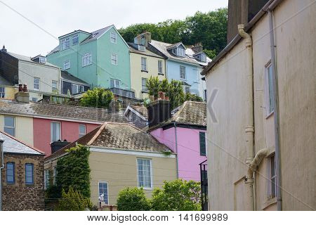 DARTMOUTH, UK - JULY 6: Colourful exterior paint brightens a group of houses on a hillside in the coastal town of Dartmouth, England on July 6, 2016.