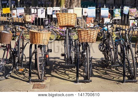 CAMBRIDGE, UK - MARCH 13: Parked bikes line the pavement in the centre of the university city of Cambridge, England on March 13, 2016.