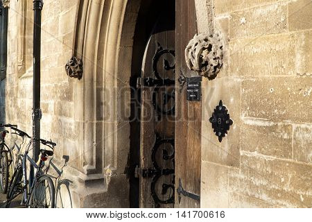 CAMBRIDGE, UK - MARCH 13: Afternoon sun strikes the open doorway at the entrance to a Trinity College student residential building in the centre of Cambridge, England on March 13, 2016.