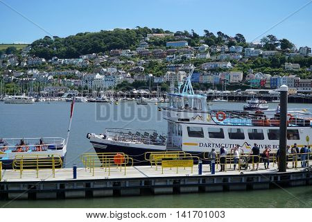 DARTMOUTH, UK - JULY 6: Passengers wait to board the Dartmouth River Boat, a passenger ferry and cruise boat serving the towns of Dartmouth and Totnes in Dartmouth, England on July 6, 2016.
