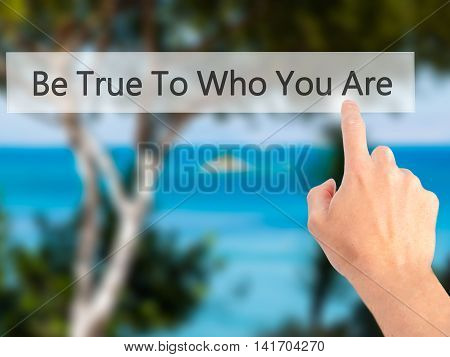 Be True To Who You Are - Hand Pressing A Button On Blurred Background Concept On Visual Screen.
