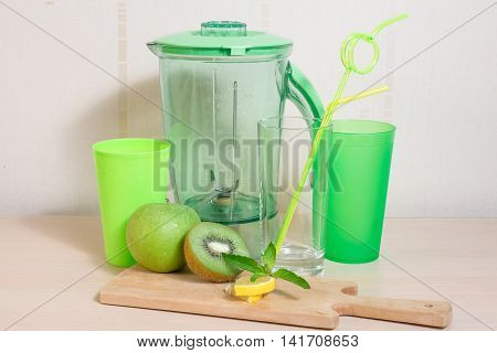 Cooking Smoothie Of Kiwi, Apple, Lemon And Mint. Blender, Knife, Glasses And Straws