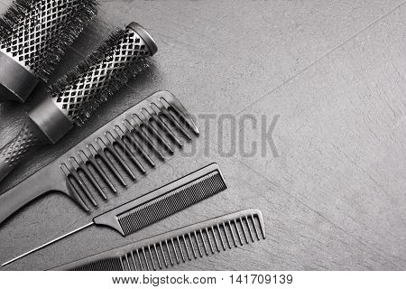 Salon Hairdresser Accessories Comb and brashing for cutting hair on a black background
