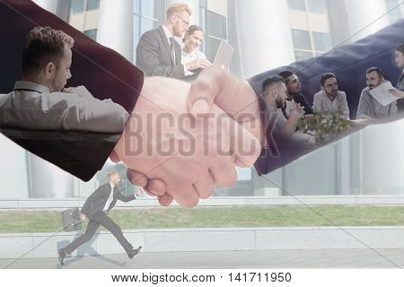 Business concept of handshake of two man across business team work and running businessman near office building. Double exposure compilation.