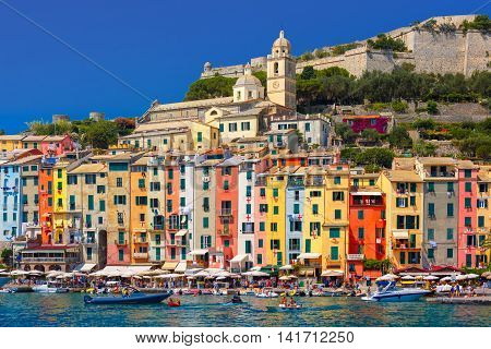 Panoramic view of colorful picturesque harbour of Porto Venere, San Lorenzo church and Doria Castle on the background, La Spezia, Liguria, Italy.