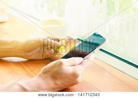 Online Payment, Hands Holding A Credit Card And Using Smart Phone For Online Shopping,credit Card Co