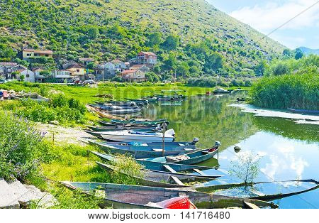 The raw of the punt boats in port of Vranjina village on Moraca river Montenegro.