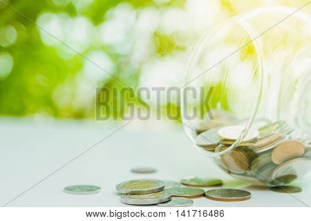 Coins In A Glass,finance Concept,business Background,money Content And Selective Focus.