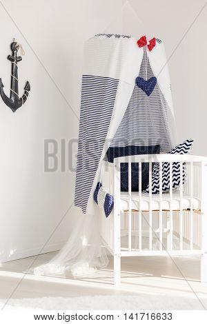 Sunny Corner Of A Newborn's Marine Room