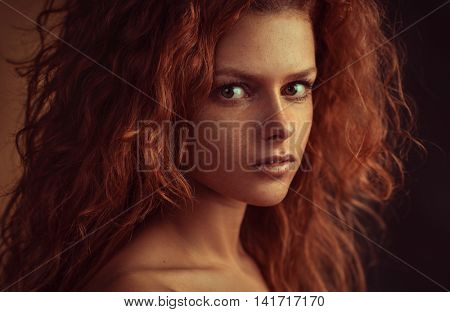 Young woman with red hair indoors portrait