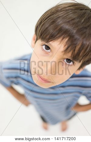 Cheerful kid on ground in studio
