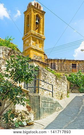 The St George Church located on the steep hill in the mountain village of Gourri Cyprus.