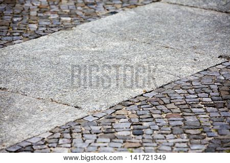 close up of sidewalk with cobble stones