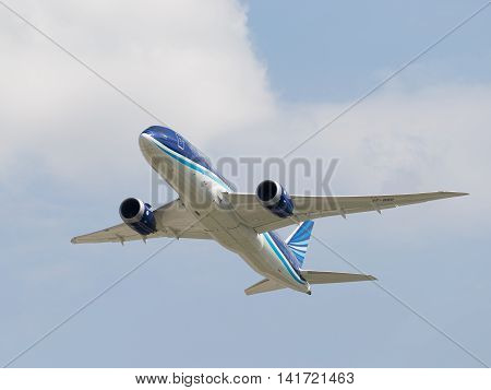 Moscow region - 31 July 2016: Blue and white passenger airplane Boeing 757-8 AZAL Azerbaijan Airlines flies to Moscow's Domodedovo airport July 31 2016 Moscow Region Russia