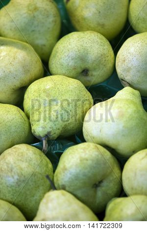close up of green pears at fruit stand