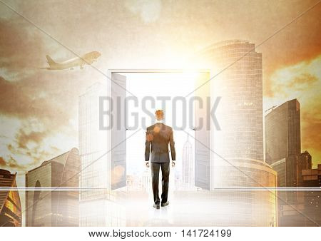 Man in suit entering door in wall with Moscow panorama pictured on it. Concept of prospective new way in business.